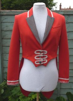 Can make jackets to order if you have something different in mind , just contact me through etsy.  Upcycled Red Ringmaster tailcoat jacket UK womens size 10 circus , steampunk ,festival  Made from a bright red womens H & M  jacket with bright red lining .  Measures chest 94 cm  shoulder to hem front 50 cm  full length back 89 cm  sleeve length 61 cm  top sleeve width 16 cm  shoulder seam 12 cm  across front 39 cm (across back 37 cm )  all the way around armhole 49 cm will post anywhere…