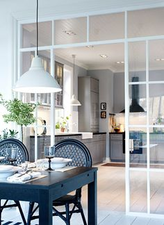 A glass wall between kitchen and living room is a perfect solution if you love open space but you need to divide the two rooms. Ikea Kitchen, Kitchen Interior, Kitchen Decor, Kitchen Dining, Kitchen Cabinets, Sweet Home, Glass Cabinet Doors, Cuisines Design, Deco Design