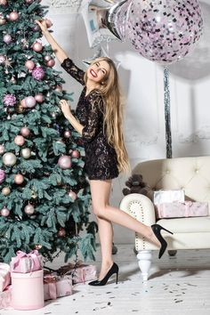 Smiling happy girl decorates the Christmas tree on the white wall background in the studio. Woman wears a nice black dress and black shoes. Holiday Outfits Women, Christmas Party Outfits, Christmas Photoshoot Ideas, Followers En Instagram, The Dress, Evening Gowns, Ideias Fashion, Clothes For Women, Italian Christmas