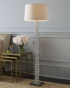 """$1200    Glamorous stacked-crystal floor lamp gives any room star power.  Hand-cut crystal base.  White cotton shade.  Uses one 100-watt bulb.  18""""Dia. x 63""""T.  Imported."""