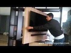 Soporte tv panel giratorio dividir 2 espacios, instalacion de televisor en mueble de madera - YouTube
