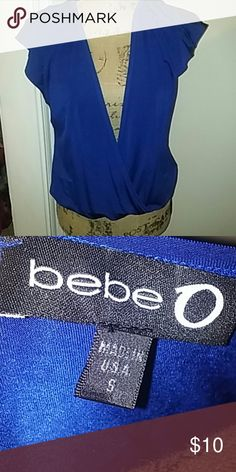Bebe Top Royal blue bebe top. Great for clubwear. Could wear a cami under it. Excellent condition. bebe Tops Blouses