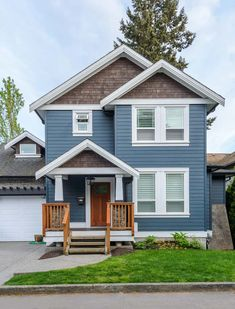 30 Houses with a Blue Exterior (Photos - All Types of Blue) The natural wood shingle look goes well with the blue siding on this home along with extensive white trim. Too bad the porch railing wood tone doesn't match the wood shingle siding. Grey Exterior, Exterior Siding, Exterior Design, Shingle Siding, Craftsman Exterior, Blue House White Trim, Light Blue Houses, Blue Siding, White Siding