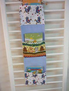 Porta livros de tecidos (para revistinhas e livros pequenos) R$ 50,00