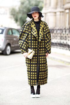 Architectural --big coats with rounded shoulders, eliptical style.