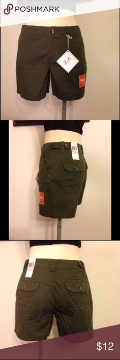 """Dockers Slimming Shorts These """"truly slimming'"""" Dockers state they flatten your tummy for the perfect look. Shorts have front zipper, front pockets and button flap rear pockets. Length is 13"""". Color is khaki green. Fabric content is 98% Cotton, 2% Elastene. NWT. Size 6. Dockers Shorts"""