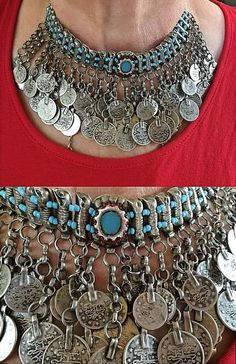 A wonderful silver kirdan necklace from Syria. With many dangling Ottoman coins and blue and red glass beads. Early 20th or late 19th century.