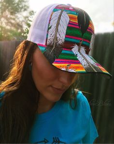 Serape Feather cap hand painted by designer Lisa Erickson. Amazing art work and One Of A Kind. Available now at Cactus Blues Boutique