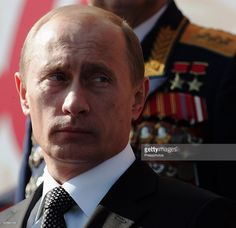 Russian President Vladimir Putin attends the annual military parade at Red Square May 9, 2006 in Moscow, Russia. Russians are celebrating the 61st anniversary of the Day of Victory over Nazi Germany during WWII.