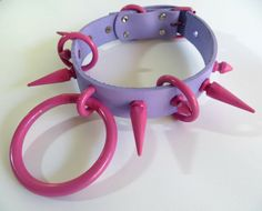 Light/Medium Purple hand-painted Genuine Leather(NonVegan) choker with Bubblegum Pink powder coated metal hardware. The pink tends to look brighter on mobile phones than it is in person. For accuracys sake, its about a FF99CC if you google an html color chart. Hehe. Fits necks 13.5-17inches(tightly). This is a ready to ship collar. Please allow me 3-5 days to ship it out. If you have any questions please contact me! This collar CAN be made in Vegan materials via custom order(same cost)…