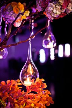 Teardrop shaped glass terrariums hang from branches & blossoms - what a whimsical light up party decor idea. Hang in the yard, or make them petite-style as DIY table centerpieces. Fill with LED tealight candles for safety: http://www.flashingblinkylights.com/light-up-products/flickering-led-candles.html
