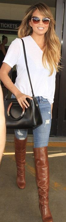 Who made Chrissy Teigen's handbag, skinny ripped jeans, brown over the knee boots, and cat sunglasses?