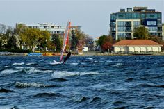 Whitecaps by Henrik Nordstrom on Capture Minnesota // A windsurfer breezes his way along Lake Calhoun towards Uptown on a late autumn sail