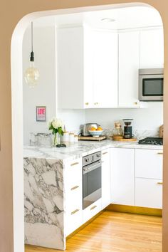 When Elise and Ben bought their Mount Washington house, the kitchen looked like this. They used this sad kitchen for five years until they finally updated it. The end result is modernized, but still captures the spirit and integrity of the storied older house.