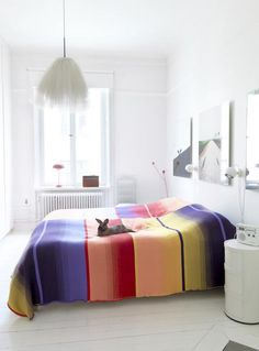 white room, bright bed: tulle light + bunny rabbit too!