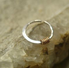 Nose Rings Sterling Silver with 14k Pink Gold Filled Wrap 22 gauge Nose Jewelry Collection. $9.00, via Etsy.