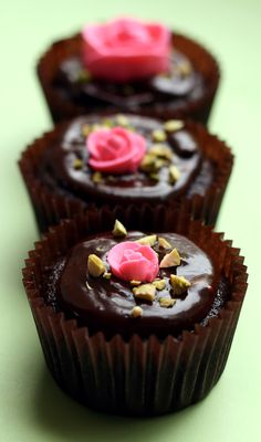 One bowl chocolate cupcakes with chocolate ganache, chopped pistacios, and royal icing roses. So simple and pretty.