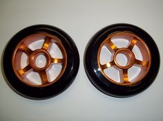 Metal Core Scooter Wheels 100mm BLACK and ORANGE Heavy Duty RAZOR Set with Bearings(item#122076100) by Unknown. $19.95. Scooter Wheels. Metal Core 122076100 Scooter Scooter Wheels-Orange-100,Orange,100mm. Scooter Wheels w/Bearings 100mm Metal Core 122076100 Scooter Scooter Wheels-Orange-100,Orange,100mm