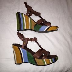 Nine West platform sandals This is an awesome pair of heels!  Leather straps.  Multi-color fabric covered platform heels.  In excellent used condition.  Very comfy to wear!  Looks great with everything!  I think they retailed for around $80. Nine West Shoes Sandals