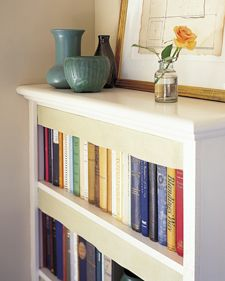 Smart tip stolen from Swedish libraries: Hang linen from shelves to protect books from gathering dust.