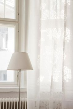 Sammaltähkä (burn-out) curtain by Vallila, white lampshade: looks so elegant. Lovelovelove burn-out fabrics!