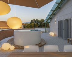 This modern vacation home in Lucca, a walled city in Italy's Tuscany region, features minimalist design and furnishings, a mini-pool and a terrace. Patio Slabs, Patio Fence, Raised Patio, Cement Patio, Pergola Patio, Patio Decks, Patio Swing, Patio Roof, Patio Table