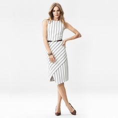 The classic sheath elevated—this striped sheath dress is designed with a modern asymmetric wrapped skirt creating an angular look that flatters impeccably. #whbm
