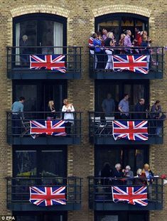 Colours to the mast: People living along the Thames delighted in showing their support for the Queen's Diamond Jubilee by draping the Union Flag their homes