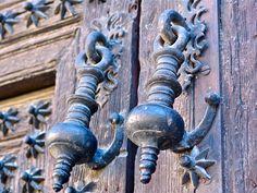 Large door knockers affixed to ancient doors in Madrid, Spain (juliegilley.typepad.com)