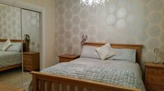 My bedroom.  Laura Ashley coco design wallpaper and bedding.   Loving it!