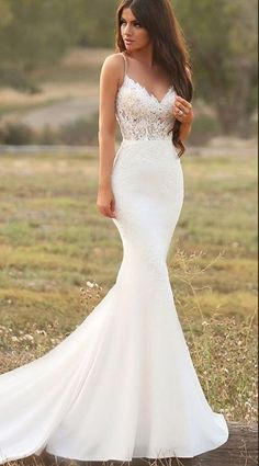 White wedding dress. Brides dream about finding the most appropriate wedding ceremony, however for this they need the most perfect bridal gown, with the bridesmaid's dresses complimenting the brides dress. Here are a few ideas on wedding dresses. #weddinggowns #weddingideas #weddingdress