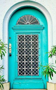 Turquoise door in Berlin, Germany.