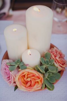 Succulents + Rose + Pillar Candles = Simple and Beautiful Wedding Centerpiece. Romantic candles and wedding ideas, get inspired at www.scentedcandleshop.com.