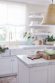 Kitchen Interior Remodeling Beautiful white kitchen inspiration with gold accents - Nicole Davis Interiors - Whether you love white kitchens, open shelving, rustic or modern styles, you'll find lots of beautiful kitchen inspiration here. Gold Kitchen Hardware, White Kitchen Cabinets, Kitchen Cabinet Design, Kitchen White, Gold Hardware, Brass Kitchen, Country Kitchen, Kitchen Shelves, Glass Shelves