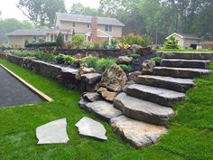 Gorgeous Front Yard Retaining Wall Ideas For Front House 05 Boulder Retaining Wall, Retaining Wall Steps, Backyard Retaining Walls, Sloped Yard, Sloped Backyard, Landscape Stairs, Landscape Design, Landscaping On A Hill, Landscaping Ideas