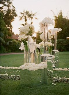 Ceremony Idea #2: We could place mirrored pedestals up front to reflect the sea and sky, and place vessels of monochromatic flowers in different varieties on top of each one at varying heights.