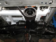 Underside of motor compartment showing 1985 celica GTS differential and belt drive