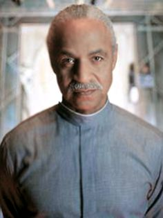 Ron Glass as Book