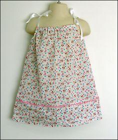 Image from http://thelongthread.com/wp-content/uploads/2008/04/pillowcase-dress.jpg.