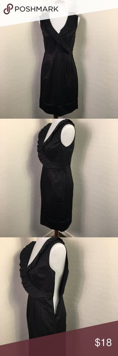 """Black Sleeveless Dress Sz 4 Ann Taylor Loft Excellent condition with no signs of wear, its missing its belt but can be worn without it or can be replaced with any other belt you have. Sleeveless with Ruffled v-neck, left side zip and hook and eye closure, size 4 Regular with the following measurements: shoulder width is 15 1/2"""" flat lay, armpit to armpit (bust) is 17 1/2"""" across, waist is 15"""" across, length is 35 1/2"""". Ann Taylor Loft Dresses"""