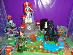 """Disney's New Princess Merida from """"BRAVE"""" Cake. - From the first day my daughter saw the trailer she decided she wanted her fourth birthday party to be of Merida from the new Disney movie """"Brave"""". This cake was very challenging for me to actually think of but once I new  how I wanted it , everything from there was easy. Since I run and own my online store, Go to school and work I really did't  have the time to make the actual cake so I prepared a dummie/fake cake for my daughters party and…"""