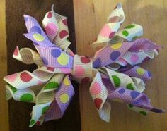 Curly dots bow by MissAlexisBowtique on Etsy, $4.50