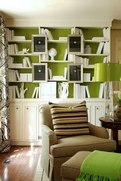 Tobi Fairley - Green & Tan den with white built-ins with back of shelf painted bright ...