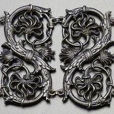 Detail of bracelet is composed of six scrolling serpentine shaped links with foliate mounts completed by a rectangular clasp with a central oval rosette and opposing foliate mounts.  Ca. 1810  Stamped: Geiss A Berlin  Length: 7 inches  Provenance: Purchased from an East Coast collector