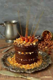 Mini chocolate layer cake baked in a tin can, with nutella ganache, toasted hazelnut praline and candied hazelnuts, serves 2-4.