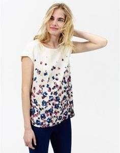 Crafted from a fabric that drapes beautifully, this floral printed top with a flattering gathering at the back, is all set to be one you'll wear again and again.