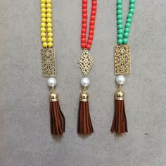 DIY tutorial for colourful beaded tassel necklaces with filigree, pearls and tassels. I made these 3 in 5 minutes! :) Quick and simple.