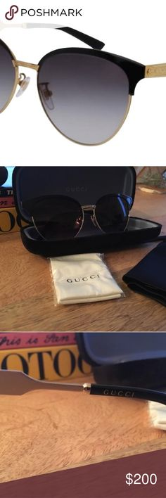Gucci Sunglasses - Never worn! Brand new - never worn. Purchased at Gucci store in Italy.  100...100% authentic and literally new. Paid over asking price (approx $420 with tax).  Size: 58 15-150 (eye, bridge, temple) Black/Gold Grey Gradient Lens Oval/Cat Eye shape Metal frame  Lens CR39 is a lightweight  scratch resistant plastic.   Accessories: Full authentic original velvet Gucci case and never opened lens cloth, plus satin carrying bag and Gucci shopping bag.  Avail in Gucci store now…