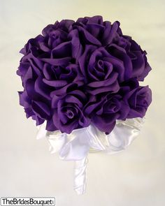 my wedding bouquet - purple roses LOVE!! so simple! this is what i want.