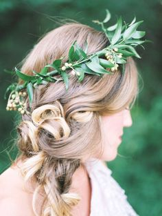 With an olive branch crown: http://www.stylemepretty.com/collection/2529/